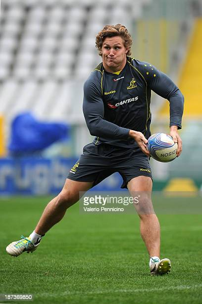 Michael Hooper of the Wallabies passes the ball during the Australian Wallabies captain's run at Olimpico Stadium on November 8 2013 in Turin Italy