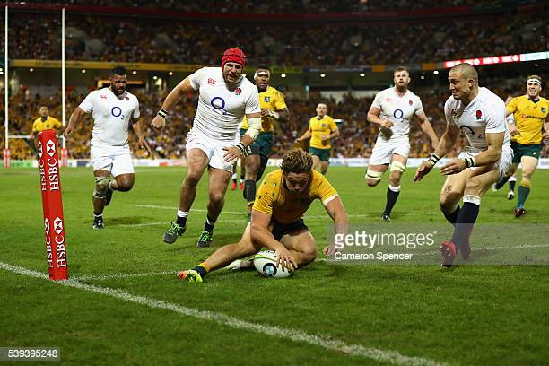 Michael Hooper of the Wallabies scores a try during the International Test match between the Australian Wallabies and England at Suncorp Stadium on...