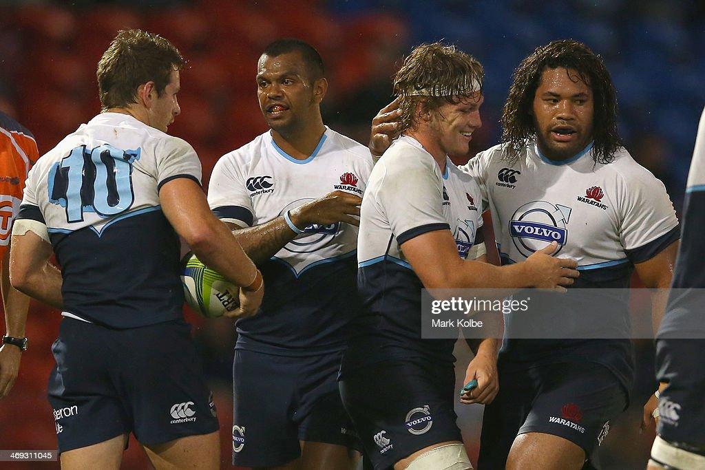 <a gi-track='captionPersonalityLinkClicked' href=/galleries/search?phrase=Michael+Hooper&family=editorial&specificpeople=676799 ng-click='$event.stopPropagation()'>Michael Hooper</a> of the Waratahs celebrates scoring a try with Tatafu Polota Nau of the Waratahs during the Super Rugby trial match between the Waratahs and the Highlanders at Hunter Stadium on February 14, 2014 in Newcastle, Australia.