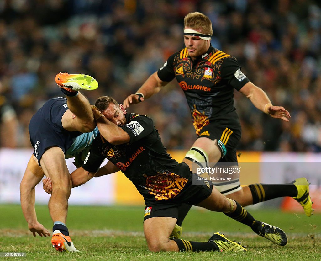 <a gi-track='captionPersonalityLinkClicked' href=/galleries/search?phrase=Michael+Hooper&family=editorial&specificpeople=676799 ng-click='$event.stopPropagation()'>Michael Hooper</a> of the Waratahs is tackled by <a gi-track='captionPersonalityLinkClicked' href=/galleries/search?phrase=Aaron+Cruden&family=editorial&specificpeople=5501441 ng-click='$event.stopPropagation()'>Aaron Cruden</a> of the Chiefs during the round 14 Super Rugby match between the Waratahs and the Chiefs at Allianz Stadium on May 27, 2016 in Sydney, Australia.