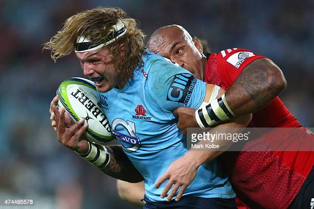 Michael Hooper of the Waratahs is tackled by Nemani Nadolo of the Crusaders during the round 15 Super Rugby match between the Waratahs and the...