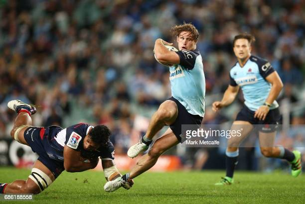 Michael Hooper of the Waratahs is tackled during the round 13 Super Rugby match between the Waratahs and the Rebels at Allianz Stadium on May 21 2017...