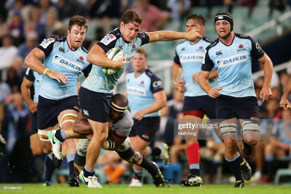 Michael Hooper of the Waratahs is tackled during the round nine Super Rugby match between the Waratahs and the Kings at Allianz Stadium on April 21, 2017 in Sydney, Australia.