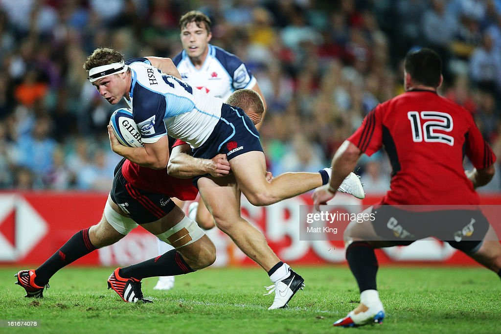Michael Hooper of the Waratahs is tackled during the Super Rugby trial match between the Waratahs and the Crusaders at Allianz Stadium on February 14, 2013 in Sydney, Australia.