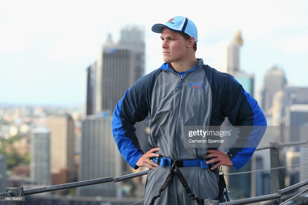 Michael Hooper of the Waratahs poses on top of the Sydney Harbour Bridge during a Waratahs promotional event during their season launch on February 6, 2013 in Sydney, Australia.