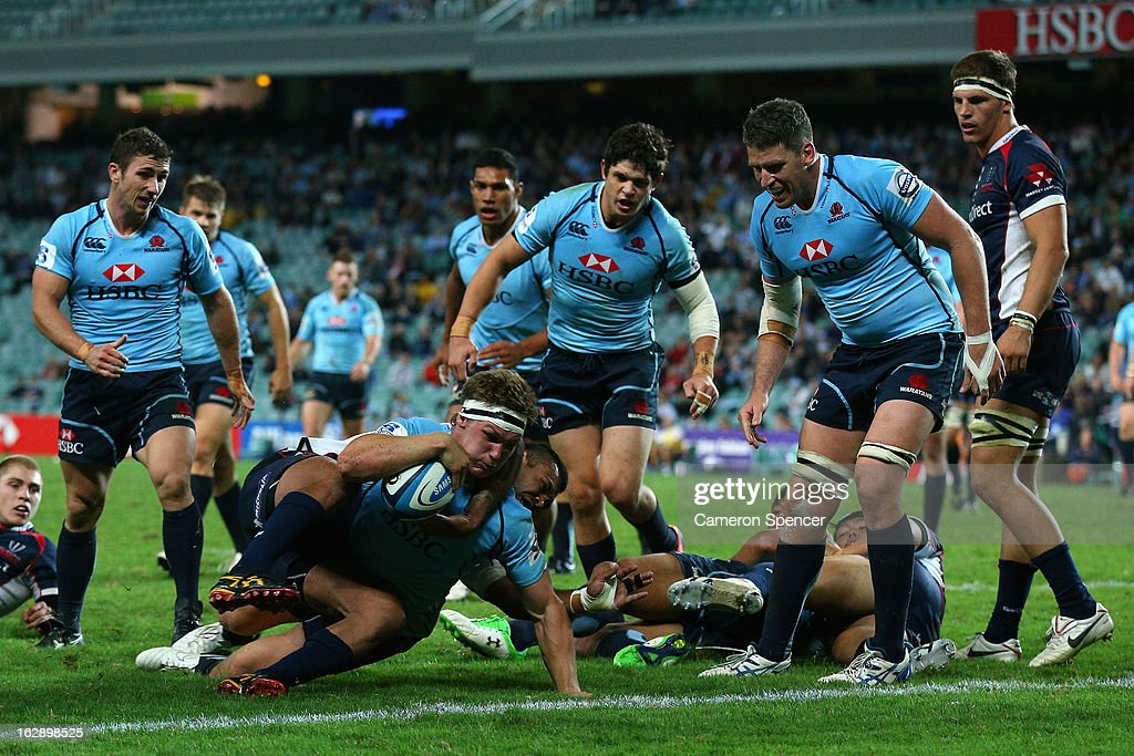 Michael Hooper of the Waratahs scores a try during the round three Super Rugby match between the Waratahs and the Rebels at Allianz Stadium on March 1, 2013 in Sydney, Australia.