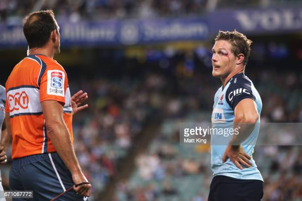 Michael Hooper of the Waratahs speaks to referee Rohan Hoffman during the round nine Super Rugby match between the Waratahs and the Kings at Allianz...