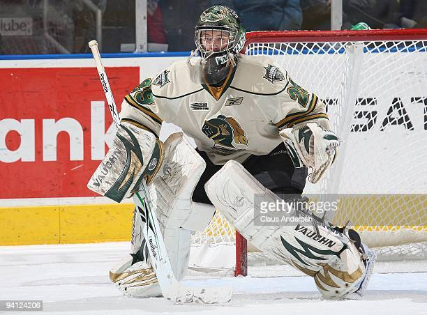 Michael Houser of the London Knights keeps an eye on the play in a game against the Sault Greyhounds on December 62009 at the John Labatt Centre in...