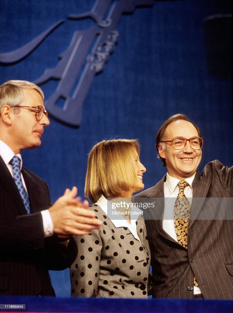 Michael Howard MP of Conservative Party with wife Sandra and former Prime Minister John Major at the Conservative Party Conference in 1995