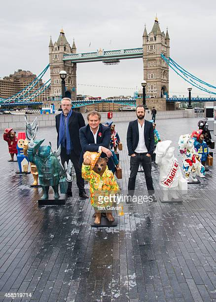 Michael Howells Hugh Bonneville and Ryan McElhinney attend the launch of The Paddington Trail at The Scoop More London on November 3 2014 in London...