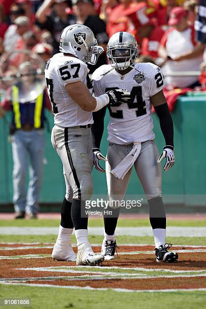 Michael Huff and Ricky Brown of the Oakland Raiders talk after a big play against the Kansas City Chiefs at Arrowhead Stadium on September 20 2009 in...
