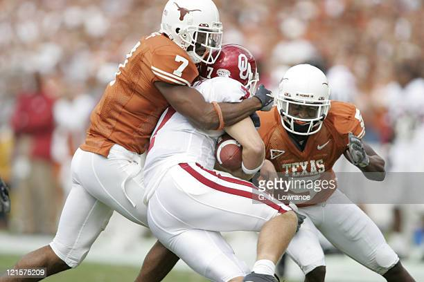 Michael Huff and Tarell Brown of the Texas Longhorns broomg down Rhett Bomar during action against the Oklahoma Sooners in the 100th annual Red River...