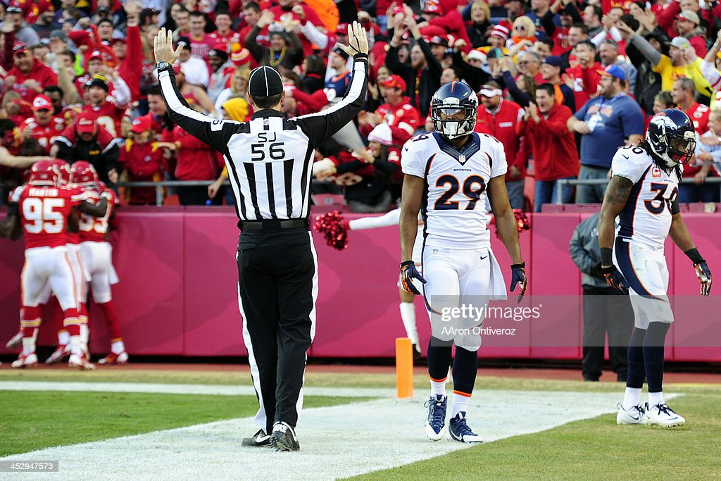<a gi-track='captionPersonalityLinkClicked' href=/galleries/search?phrase=Michael+Huff&family=editorial&specificpeople=648298 ng-click='$event.stopPropagation()'>Michael Huff</a> (29) of the Denver Broncos and <a gi-track='captionPersonalityLinkClicked' href=/galleries/search?phrase=David+Bruton&family=editorial&specificpeople=4023057 ng-click='$event.stopPropagation()'>David Bruton</a> (30) of the Denver Broncos react after Knile Davis (34) of the Kansas City Chiefs took a kickoff back for a touchdown during the first half of action at Arrowhead Stadium. The Denver Broncos visit the Kansas City Chiefs in an AFC West showdown.