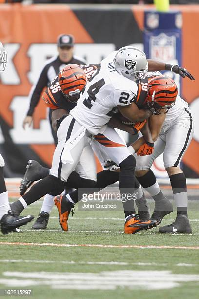 Michael Huff of the Oakland Raiders makes the tackle during the game against the Cincinnati Bengals at Paul Brown Stadium on November 25 2012 in...