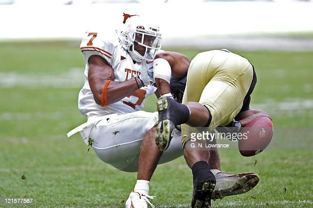 Michael Huff of the Texas Longhorns forces a fumble versus the Colorado Buffalos in the Big 12 Championship at Reliant Stadium in Houston Texas on...