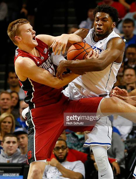 Michael Humphrey of the Stanford Cardinal battles Justise Winslow of the Duke Blue Devils for a rebound during the first half of the championship...