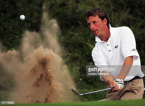Michael Hunt of England plays from a bunker on the 13th hole during his semifinal versus David Peel of England at The British MidAmateur Championship...