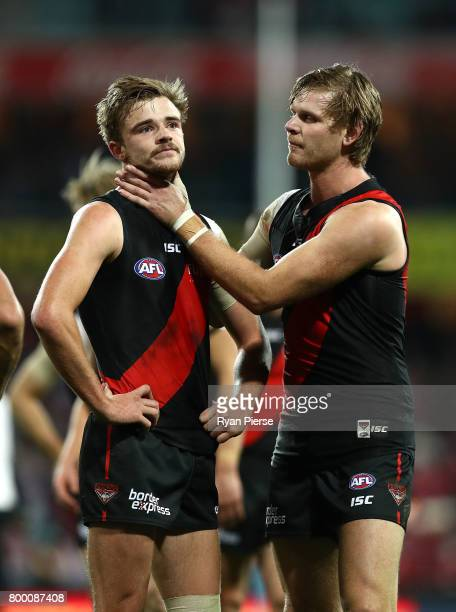 Michael Hurley and Martin Gleeson of the Bombers look dejected after the round 14 AFL match between the Sydney Swans and the Essendon Bombers at...