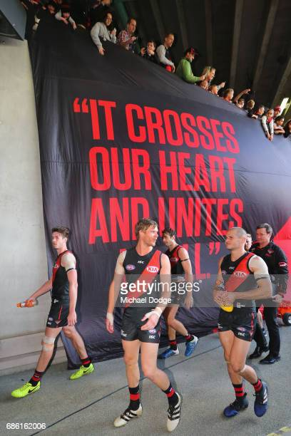 Michael Hurley of the Bombers celebrates the win with David Zaharakis during the round nine AFL match between the Essendon Bombers and the West Coast...