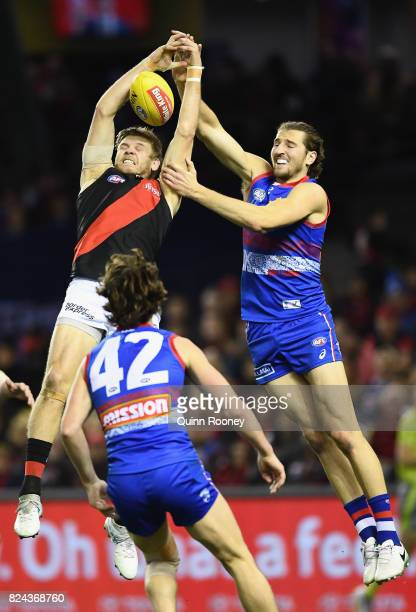 Michael Hurley of the Bombers marks infront of Marcus Bontempelli of the Bulldogs during the round 19 AFL match between the Western Bulldogs and the...
