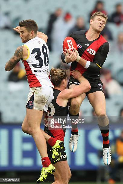 Michael Hurley of the Bombers marks the ball against Jeremy Howe of the Demons during the round 15 AFL match between the Essendon Bombers and the...
