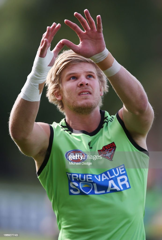 Michael Hurley of the Bombers marks the ball with his bandaged up hands during an Essendon Bombers AFL training session at Windy Hill on April 19, 2013 in Melbourne, Australia.
