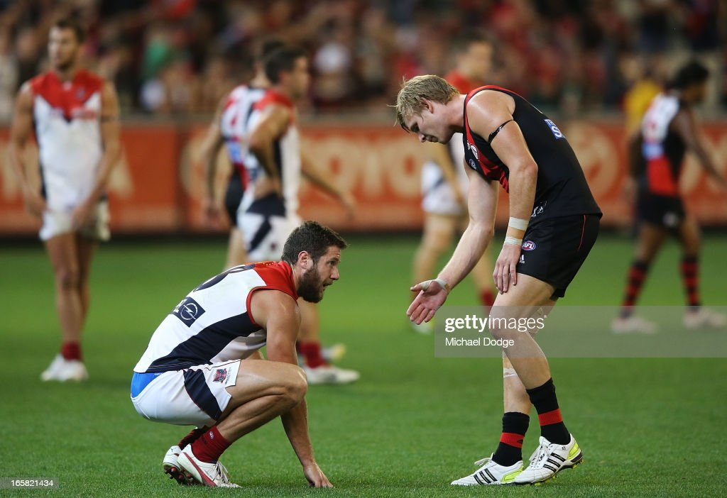 Michael Hurley (R) of the Bombers offers a handshake to James Frawley of the Demons after the final siren during the round two AFL match between the Essendon Bombers and the Melbourne Demons at Melbourne Cricket Ground on April 6, 2013 in Melbourne, Australia.