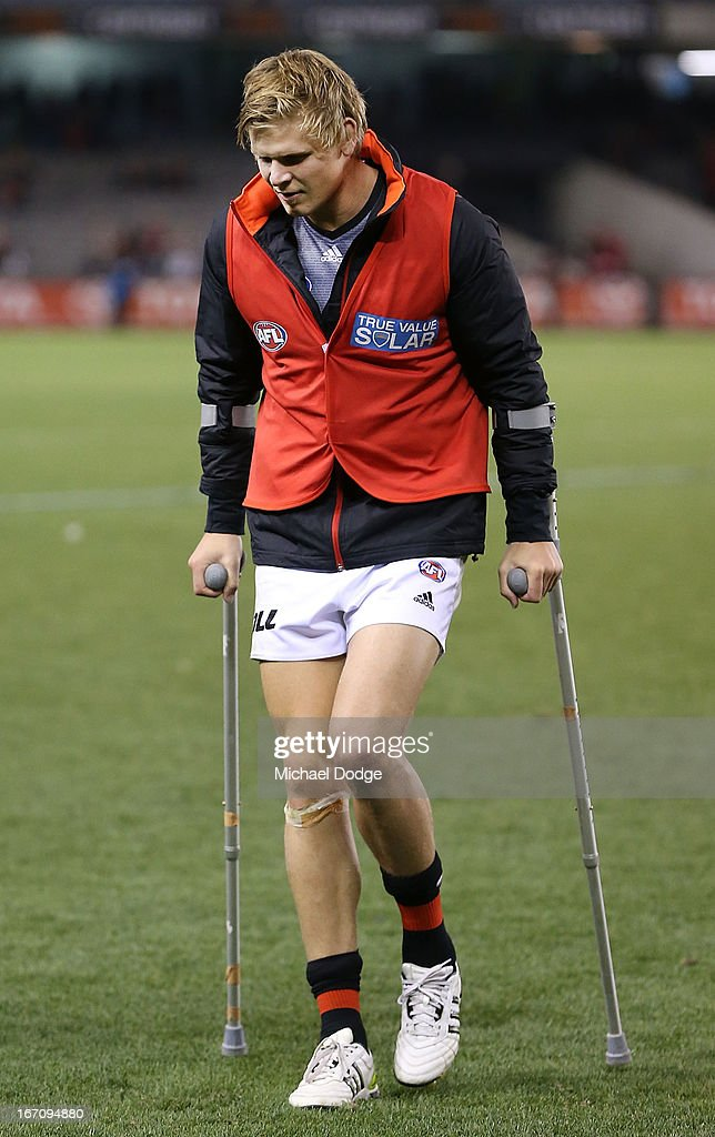 Michael Hurley of the Bombers walks off with crutches after sustaining a leg injury during the round four AFL match between the St Kilda Saints and the Essendon Bombers at Etihad Stadium on April 20, 2013 in Melbourne, Australia.