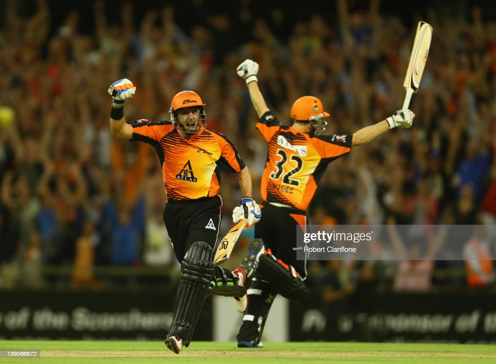 <a gi-track='captionPersonalityLinkClicked' href=/galleries/search?phrase=Michael+Hussey&family=editorial&specificpeople=171690 ng-click='$event.stopPropagation()'>Michael Hussey</a> and <a gi-track='captionPersonalityLinkClicked' href=/galleries/search?phrase=Adam+Voges&family=editorial&specificpeople=724770 ng-click='$event.stopPropagation()'>Adam Voges</a> of the Perth Scorchers celebrate after the Scorchers defeated the Stars during the Big Bash League semi-final match between the Perth Scorchers and the Melbourne Stars at the WACA on January 16, 2013 in Perth, Australia.