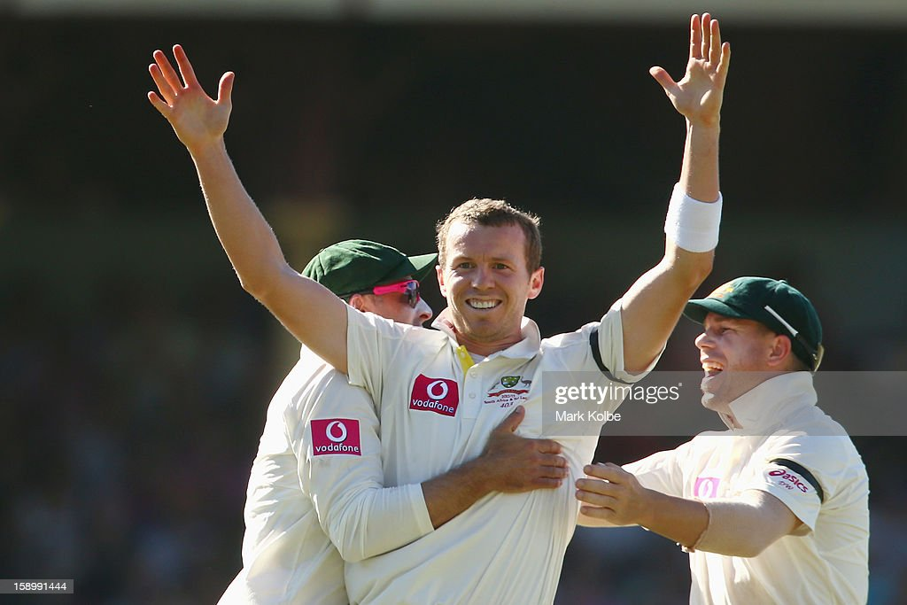 Michael Hussey and David Warner of Australia congratulate Peter Siddle of Australia as he celebrates taking the wicket of Mahela Jayawardene of Sri Lanka during day three of the Third Test match between Australia and Sri Lanka at Sydney Cricket Ground on January 5, 2013 in Sydney, Australia.
