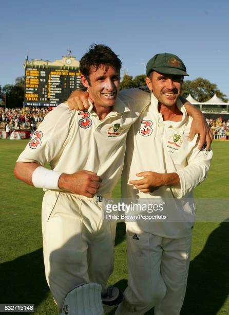 Michael Hussey and Justin Langer of Australia celebrate winning the 2nd Test match between Australia and England by 6 wickets at the Adelaide Oval...