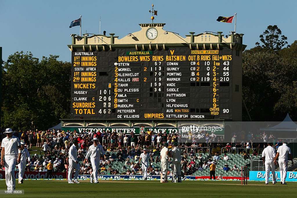 Michael Hussey and Michael Clarke of Australia look at the scoreboard during their partnership during day one of the 2nd Test match between Australia and South Africa at Adelaide Oval on November 22, 2012 in Adelaide, Australia.