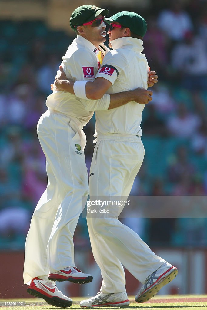 Michael Hussey and Peter Siddle of Australia celebrate after Hussey caught Thilan Samaraweera of Sri Lanka during day three of the Third Test match between Australia and Sri Lanka at Sydney Cricket Ground on January 5, 2013 in Sydney, Australia.