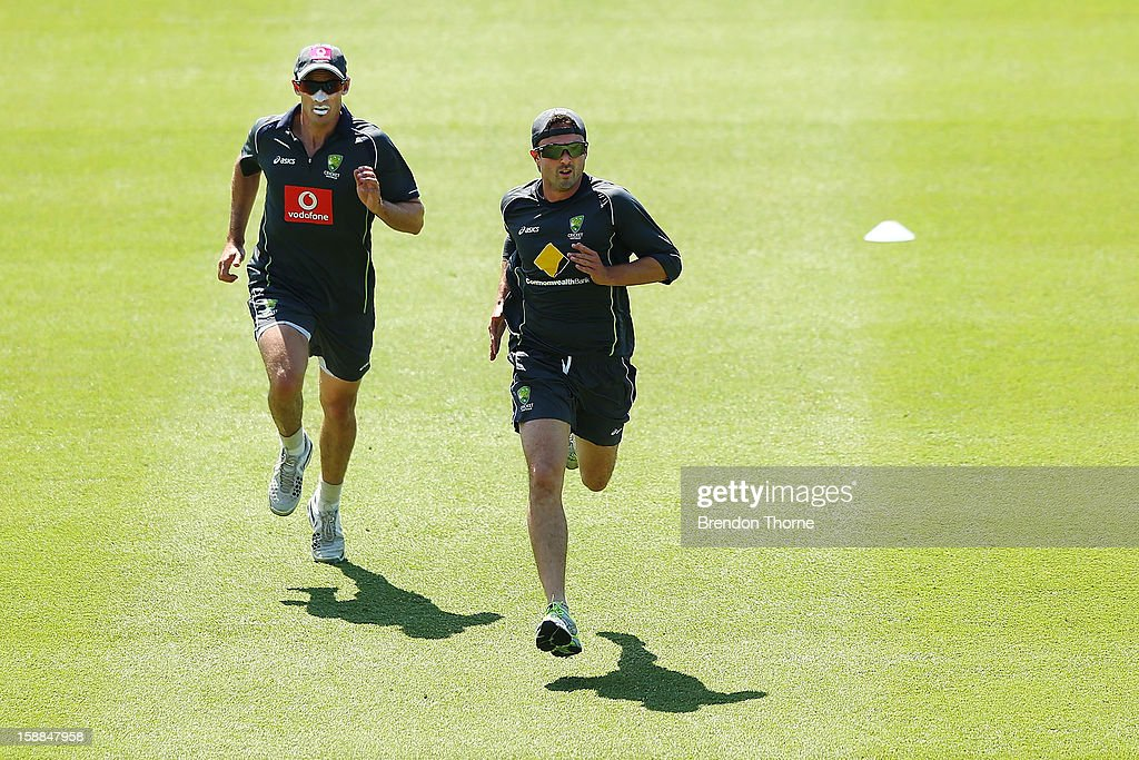 <a gi-track='captionPersonalityLinkClicked' href=/galleries/search?phrase=Michael+Hussey&family=editorial&specificpeople=171690 ng-click='$event.stopPropagation()'>Michael Hussey</a> and <a gi-track='captionPersonalityLinkClicked' href=/galleries/search?phrase=Phillip+Hughes+-+Cricketer&family=editorial&specificpeople=757530 ng-click='$event.stopPropagation()'>Phillip Hughes</a> of Australia warm up during an Australian training session at Sydney Cricket Ground on January 1, 2013 in Sydney, Australia.