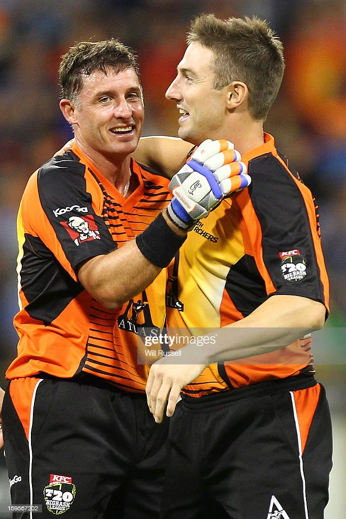 Michael Hussey and Shaun Marsh of Scorchers celebrate after their team's victory during the Big Bash League semi-final match between the Perth Scorchers and the Melbourne Stars at the WACA on January 16, 2013 in Perth, Australia.