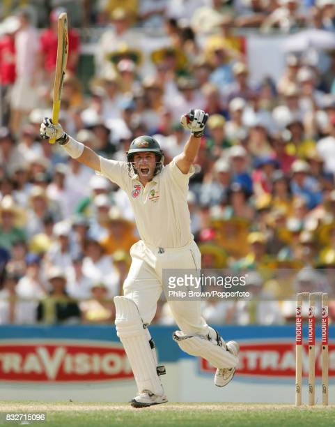 Michael Hussey celebrates reaching his century during his innings of 103 in the 3rd Test match between Australia and England at the WACA Perth...