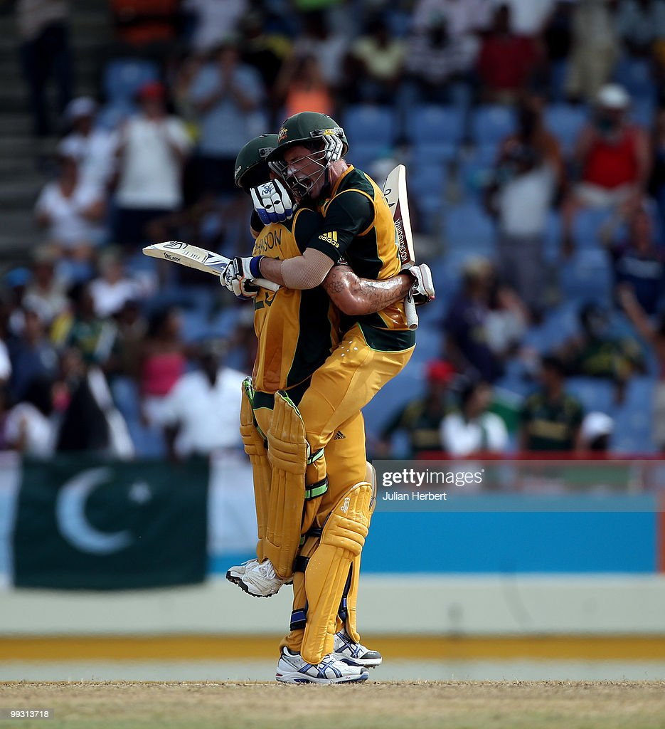 Michael Hussey (R) jumps into the arms of Mitchell Johnson after Australia beat Pakistan in the semi final of the ICC World Twenty20 at the Beausejour Cricket Ground on May 14, 2010 in Gros Islet, Saint Lucia.