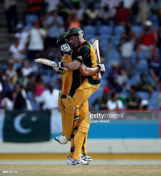 Michael Hussey jumps into the arms of Mitchell Johnson after Australia beat Pakistan in the semi final of the ICC World Twenty20 at the Beausejour...
