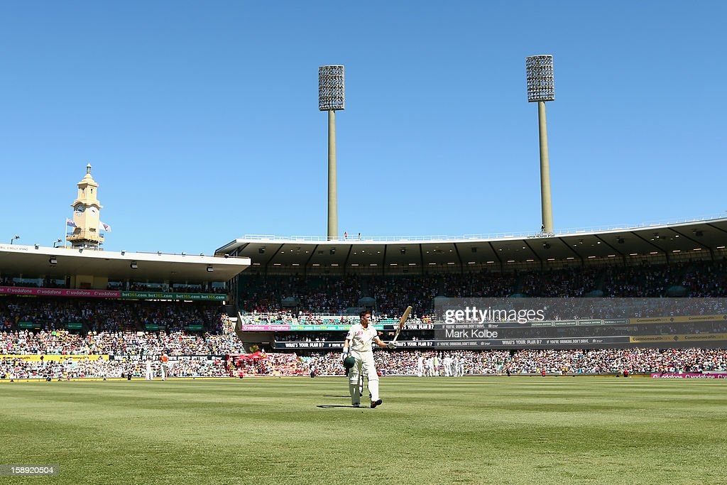 Michael Hussey of Australia acknowledges the crowd as he leaves the field after being run out during day two of the Third Test match between Australia and Sri Lanka at Sydney Cricket Ground on January 4, 2013 in Sydney, Australia.