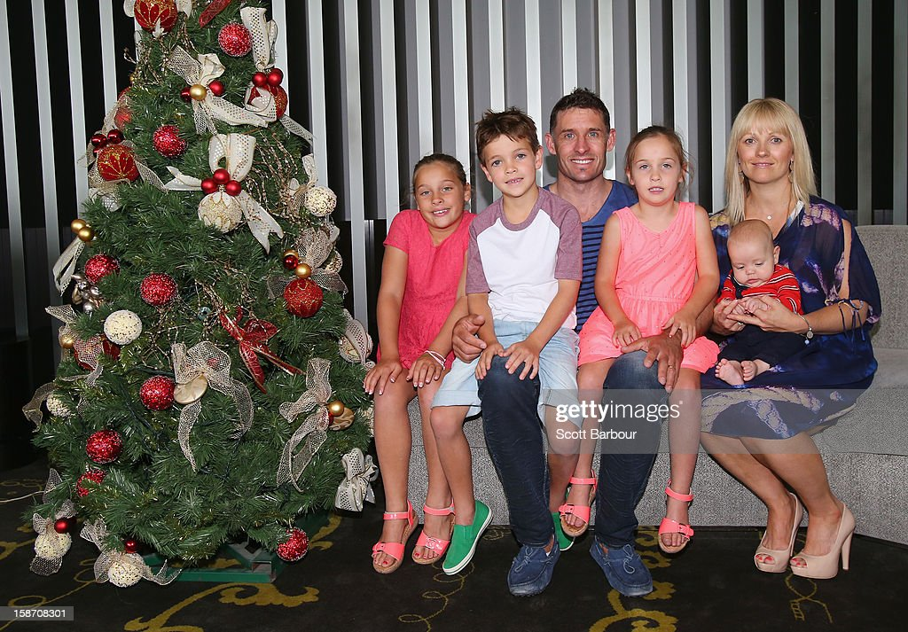 Michael Hussey of Australia along with his wife Amy Hussey pose for a photo with their children (L to R) Molly, William, Jasmin and baby Oscar next to a Christmas tree ahead of a Cricket Australia Christmas Day lunch at Crown Entertainment Complex on December 25, 2012 in Melbourne, Australia.