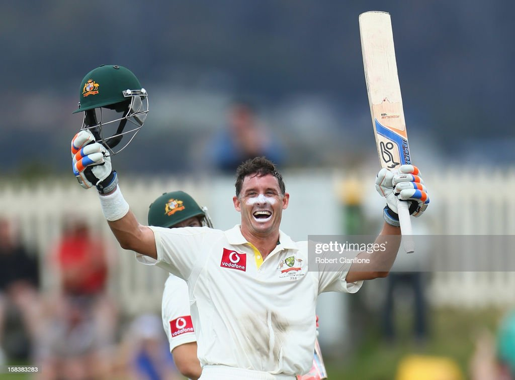 <a gi-track='captionPersonalityLinkClicked' href=/galleries/search?phrase=Michael+Hussey&family=editorial&specificpeople=171690 ng-click='$event.stopPropagation()'>Michael Hussey</a> of Australia celebrates after he scoring his century during day two of the First Test match between Australia and Sri Lanka at Blundstone Arena on December 15, 2012 in Hobart, Australia.