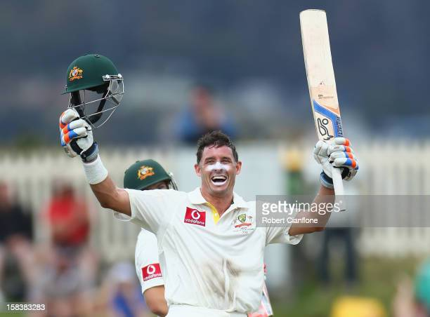 Michael Hussey of Australia celebrates after he scoring his century during day two of the First Test match between Australia and Sri Lanka at...