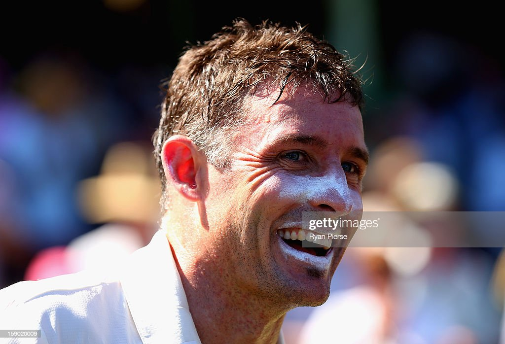 <a gi-track='captionPersonalityLinkClicked' href=/galleries/search?phrase=Michael+Hussey&family=editorial&specificpeople=171690 ng-click='$event.stopPropagation()'>Michael Hussey</a> of Australia celebrates after his last last test match during day four of the Third Test match between Australia and Sri Lanka at Sydney Cricket Ground on January 6, 2013 in Sydney, Australia.