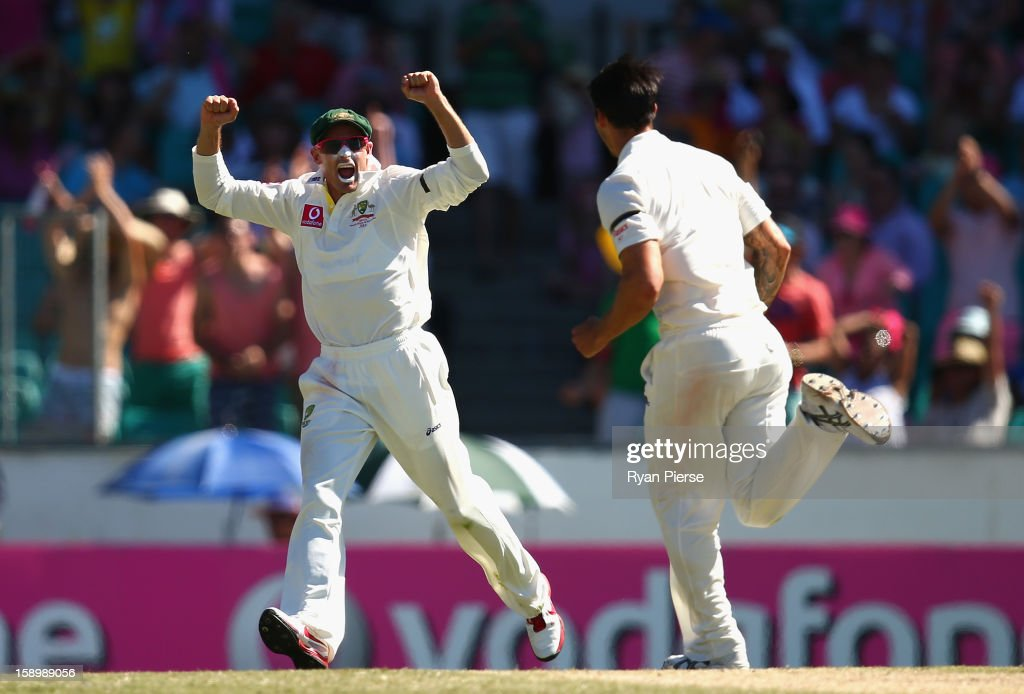 Michael Hussey of Australia celebrates after Mitchell Johnson of Australia claimed the wicket of Lahiru Thirimanne of Sri Lanka during day three of the Third Test match between Australia and Sri Lanka at Sydney Cricket Ground on January 5, 2013 in Sydney, Australia.