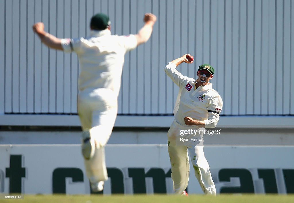 Michael Hussey of Australia celebrates after taking a catch to dismiss Thilan Samaraweera of Sri Lanka during day three of the Third Test match between Australia and Sri Lanka at Sydney Cricket Ground on January 5, 2013 in Sydney, Australia.