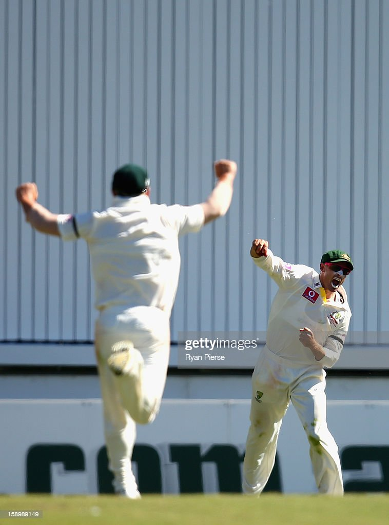 Michael Hussey of Australia celebrates after taking a catch to dismiss Thilan Samaraweera of Sri Lanka during day three of the Third Test match between Australia and Sri Lanka at Sydney Cricket Ground on January 5, 2013 in Sydney, Australia.
