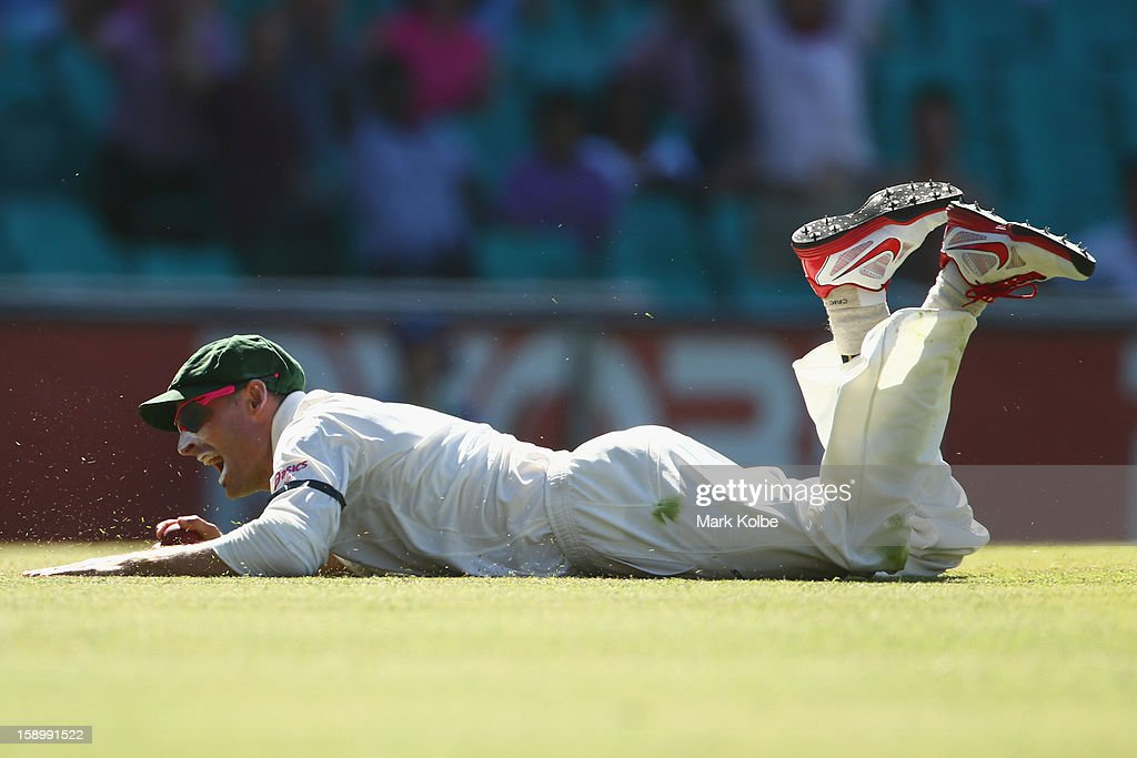 Michael Hussey of Australia celebrates catching Thilan Samaraweera of Sri Lanka during day three of the Third Test match between Australia and Sri...