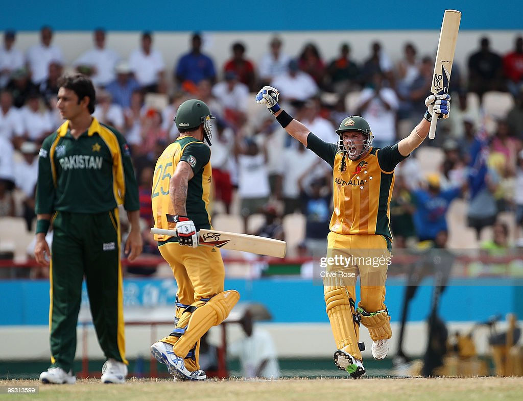<a gi-track='captionPersonalityLinkClicked' href=/galleries/search?phrase=Michael+Hussey&family=editorial&specificpeople=171690 ng-click='$event.stopPropagation()'>Michael Hussey</a> of Australia celebrates hitting the winning runs with <a gi-track='captionPersonalityLinkClicked' href=/galleries/search?phrase=Mitchell+Johnson+-+Cricketspeler&family=editorial&specificpeople=665783 ng-click='$event.stopPropagation()'>Mitchell Johnson</a> during the ICC World Twenty20 semi final between Australia and Pakistan at the Beausjour Cricket Ground on May 14, 2010 in Gros Islet, Saint Lucia.