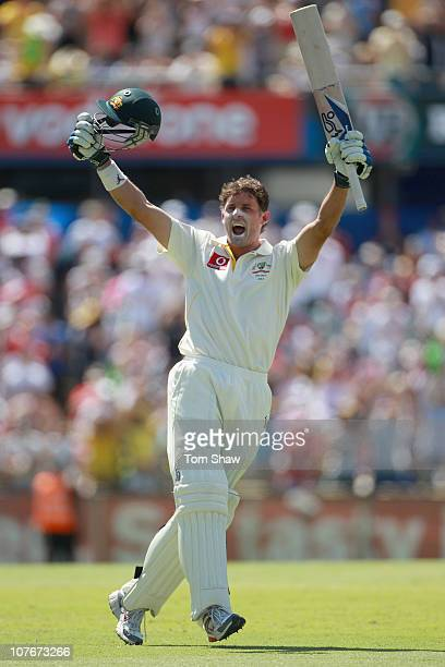 Michael Hussey of Australia celebrates reaching his century during day three of the Third Ashes Test match between Australia and England at the WACA...