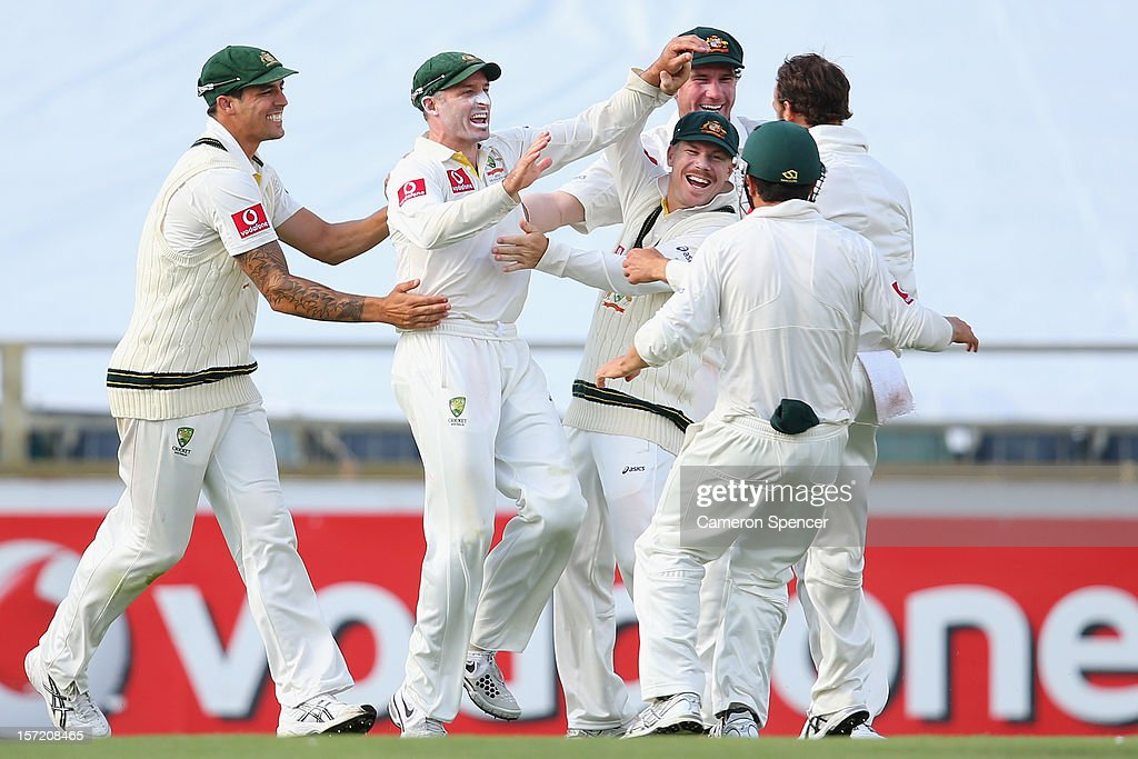 <a gi-track='captionPersonalityLinkClicked' href=/galleries/search?phrase=Michael+Hussey&family=editorial&specificpeople=171690 ng-click='$event.stopPropagation()'>Michael Hussey</a> of Australia celebrates with team mates after catching out Vernon Philander of South Africa off a delivery by team mate Nathan Lyon during day one of the Third Test Match between Australia and South Africa at the WACA on November 30, 2012 in Perth, Australia.